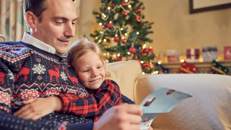 Dad with daughter reading letter from Santa